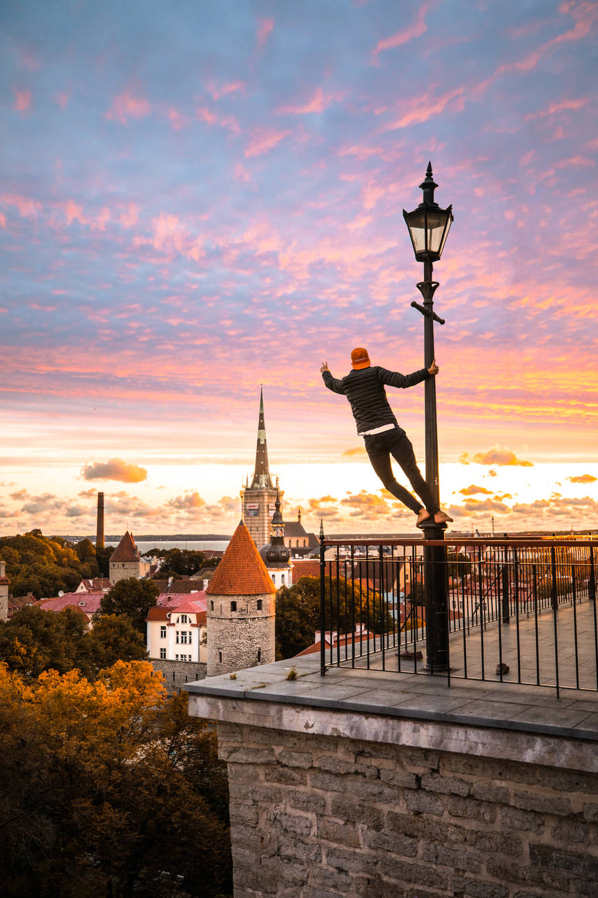 A young man looking at the sunset from the Patkuli viewing platform in Tallinn, Estonia.